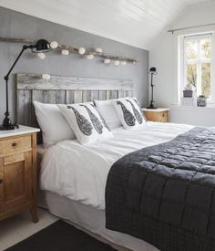 Love this grey and neutral, country modern! - tiny lanterns above bed & grey headboard