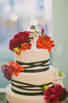 Day of the Dead cake toppers // photo by Jackie Wonders // http://ruffledblog.com/culture-chic-san-diego-wedding