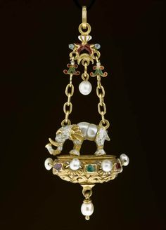 Pendant jewel of gold, enamelled and set with rubies, emeralds and pearls, an elephant on a platform with scroll work: probably Italian, 16th century