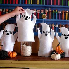 Ghost Cozies - Hide treats, cover jars in your kitchen, or just line your counters with these pop-up ghosts and ghouls.  What you'll need: ghost template, paper, white felt, black felt, craft glue, sewing machine, water soluble pen (or a pencil works just as well)