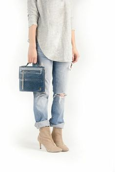 Love boyfriend jeans and heals together. That top is definitely a good addition.