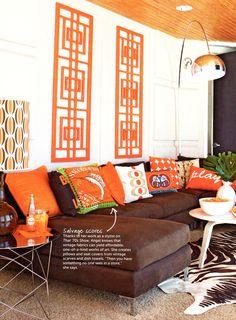 Fun living room.   Love the orange colors and retro feel.