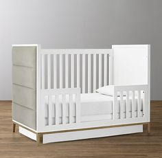 RH Baby & Child's Loew Upholstered Crib:Italian modernist design of the 1950s and 1960s informs the clean-lined simplicity of our crib. The slender metal base creates a refined silhouette while generously padded horizontal channels add soft, sculptural appeal.