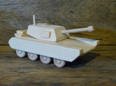 If only my nephews were little boys again I'd buy them this Wood Toy Army Tank M1A1 by OutOnALimbADK on Etsy, $29.00
