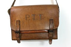 "Classic French postman leather satchel All Made from a very strong brown leather 100% leather With braces and great ""PTT"" print and pocket insideYou can see the signs of time and very nice faded -- <b>measure </b>large : 11"" long : 14""deep : 4,5"""