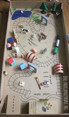 Train Tracks Small World in a Cardboard Box - The Imagination Tree- train tracks in a box small world play, Pretend play without the expensive train table. — The Imagination Tree Cardboard Tubes, Cardboard Crafts, Craft Activities, Toddler Activities, Toddler Toys, Indoor Activities, Kids Crafts, Diy Niños Manualidades, Imagination Tree