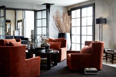 the red chairs create a bold contrast in the room and catches my eye Autumn Interior, Interior Styling, Interior Design, Contemporary Dining Chairs, Living Room Chairs, Side Chairs, Lodges, Living Spaces, Living Rooms