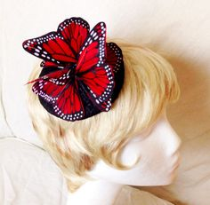 A personal favorite from my Etsy shop https://www.etsy.com/listing/245750126/red-and-black-feather-monarch-butterfly