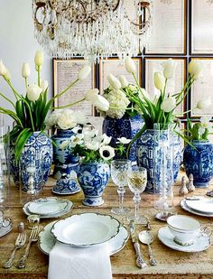 What a lovely collection of blue and white ginger jars, white china and white tulips. Who wouldn't want to have a meal at this table? Blue And White Vase, White Tulips, White Vases, White Flowers, Blue Vases, White Centerpiece, Cobalt Blue, Tulip Centerpieces, Blue Green