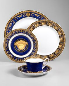 Versace Plates - love the Blue and Gold Colouring - very elegant! Maybe OTT but I still like!