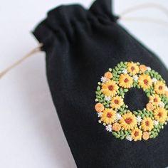 * . ひまわりのミニ巾着 . . #刺繍#手刺繍#ステッチ#手芸#embroidery#handembroidery#stitching#needlework#자수#broderie#bordado#вишивка#stickerei#ハンドメイド#handmade
