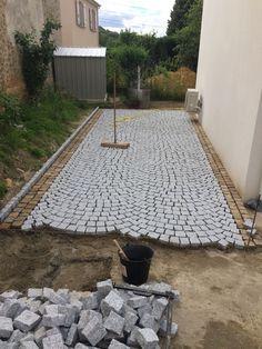 pose de pavés en granit du Portugal.
