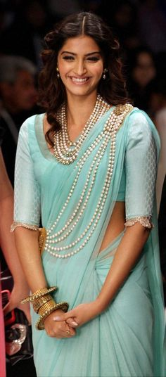 for the wedding ceremony - Sonam looks gorgeous in a chiffon saree, pearls and big smile.