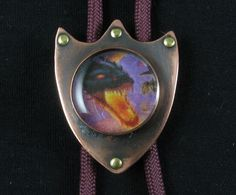 Bolo tie, copper with decorative brass rivets and patina, Fire dragon shield 001 by crquack on Etsy