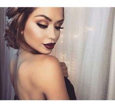 Bronze eyes , bold brows , deep berry lips , glowing bronzed skin