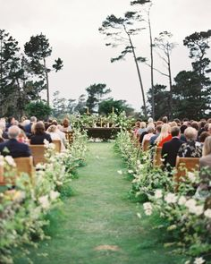 Coastside Couture Wedding at MPCC in Pebble Beach. Floral by Sarah Winward, pews from Archive Rentals Photo by Erich Mcvey