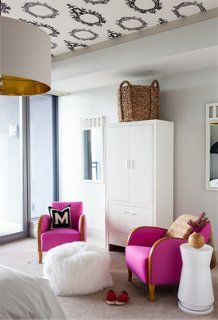 Your home should be the reflection of your unique style, so why not add hot pink chairs at the foot of your bed and wallpaper the ceiling?!