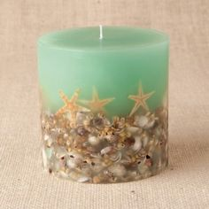 shell candle-- I might do this but with little stones