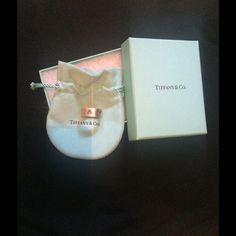 Heart cutout ring. Sterling Silver. Size 5 maybe. Worn but not busted, Tiffany & Co ring. Heart cutouts, thicker band, comes with box and bag. Maybe a size five or six. Good for the ring or middle finger for when you want to give somebody a mixed message. xoxo. Tiffany & Co. Jewelry Rings