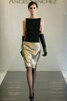 Black top & gold knee skirt ensemble by Angel Sanchez with a pair of killer leather long gloves..