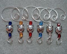 6 Silver Finish Kitty Cat Face Bead Ornament Hangers  Hooks Enhancers with glass bead accents. , via Etsy.