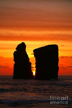 The sun sets between the Mosteiros islets - Sao Miguel island, Azores islands, Portugal