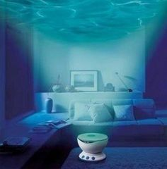 Daren is part of a wave of new mini-wave projectors that are very easy to use. Set it up in the bathroom, living room, bedroom or any space and get immersed in the deep sea calm and embrace peace. Creates a romantic, cozy atmosphere. Can be used as speaker. Connect to your MP3 Player or iPod. Package included: Boxset X 1, Mainbody X1, USB plug X1, USB Electricity Wire X1, Audio Wire X1. Please allow 7-10 days for shipping.