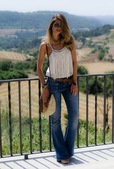 women fashion style clothing outfit jeans blue top white handbag summer sunglasses belt brown