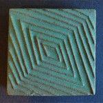 S & S (Solon & Schemmel), San Jose, CA  1921-1936 Vintage signed S & S matte green relief tile with an Art Deco-inspired geometric design.