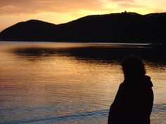 a wife looking over the setting Oban sun 2004