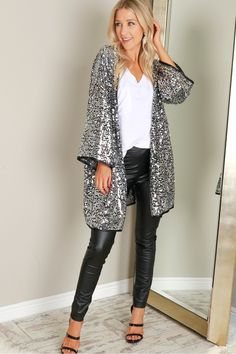 Sequin Kimono Silver, A futuristic take on the classic kimono! With an open front, this kimono cardigan is emblazoned with shiny silver sequins on all sides and is complete with black line-work along the hems.