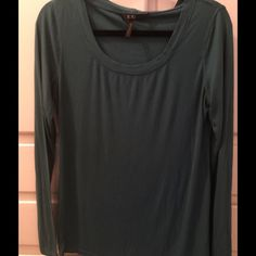 Dark Teal BCBG Top Thin, long sleeved BCBG top. So great for simple, casual look. Throw a scarf and stylish bag on with ur jeans and ur ready to go. I like that it's not heavy. Good for layering. Gently worn. Price to sell. No tears, rips, or stains. Fits true to large size. BCBG Tops Tees - Long Sleeve