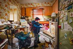 In a striking photo series showing the out-of-control clutter and junk in Geoff Johnson's late mother's Nebraska home, the photographer has his son and niece re-enact what life was like behind their always-closed doors with a mom who was a hoarder. When they were living in the home, keeping the conditions of the inside secret was paramount for fear of judgment and of social services.
