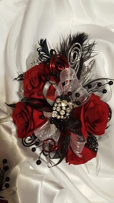 Black and red prom corsage set from Hen House Designs www.henhousedesigns.net