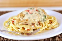 If you have a craving for tender chicken, pasta and an unbelievably tasty parmesan sauce, this copycat Olive Garden Tuscan Garlic Chicken recipe is for you! #olivegardencopycat #tuscangarlicchicken #chicken #maindish #melskitchencafe