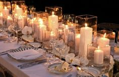 Candles as centerpieces w/ lots of glass holders, and sparkle runner down rectangular tables and stemless flowers for dreamy theme by batjas88