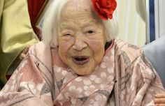 Misao Okawa, 115, who is recognised as the world's oldest living woman by Guinness World Records poses on the Doll Festival in Osaka.
