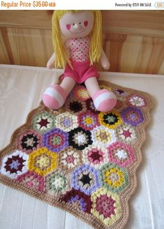 This is traditional Granny Square blanket.It is crocheted from beautiful colored acrylic yarn.The colors are used random.  This doll blanket I made