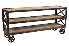 Restoration Low-Profile Bookshelf  Industrial-inspired furnishings that marry sturdy iron with weathered wood are wildly fashionable, and this dynamic bookshelf shows why. Nearly five feet wide, with wheels in lieu of feet, it's as durable as it is distinctive.