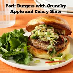 Topped with a crunchy, tart, tangy slaw and rich, creamy blue cheese, this juicy pork burger deliciously combines contrasting flavors and textures for an at-home gourmet experience.Get the recipe.   - WomansDay.com