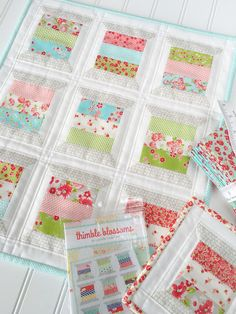 "Carried Away Quilting} ""Spools"" mini quilt.  Pattern & Little Ruby fabric by Bonnie & Camille for Moda, Stitch/Volume II fabric by Sweetwater for Moda."