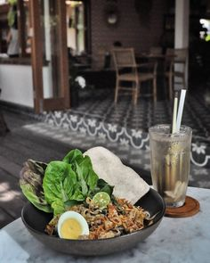 "#Bali a new ""warung style"" café serving humble Indonesia food just open in Canggu. @UlekanBali give us the feel of warm & beauty of Indonesia ambience.  We try their Gado-Gado consist of steamed vegetables soft boiled egg peanut sauce prawn kerupuk (50k) paired with their unique Ice Tea: lemongrass ginger nectar pandan (30k)"