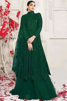 Bright and colourful, this bottle green net sharara suit which will add oodles of charm to your special ethnic look. This closed neck and full sleeve garment embellished in stone, sequins and thread work. Along with net sharara pants in bottle green color with bottle green net dupatta. Sharara pants has stone work. #shararasuits #malaysia #Indianwear #weddingwear #andaazfashion Indian Attire, Indian Wear, Pantalon Cigarette, Sharara Suit, Wear Store, Ethnic Looks, Wedding Wear, Asian Woman, Costume