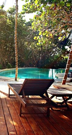 The lounger- and palm tree-dotted swimming pool invites daytime lounging. Tulum