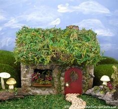 A sweet miniature berry fairy house in the fairy garden.