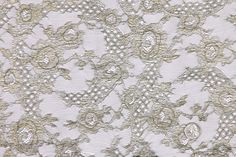 """Black Floral Isabel Toledo Chantilly Lace  Product #:FN22593C  Price: $80.00/Yard  A fine black honeycombed net hosts a dramatic gold floral design on this Chantilly lace. You\'re sure to make an entrance with this Isabel Toledo masterpiece. A touch of this fabric will take any design from ordinary to elegant. Use it as an overlay for anything from a cocktail dress to a collar.  Content:Lurex-90%  Nylon-10%  Designer:Isabel Toledo  Country:France  Width:49"""""""