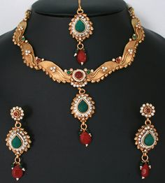 Indian designer polki bridal jewelry necklace with Emerald,Ruby Red and White polki stones-011PLKJ60  http://www.craftandjewel.com/servlet/the-1725/Indian-designer-polki-bridal/Detail
