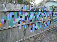 Painted fence by Kris Carlson, Tybee Island, Georgia. Hmmm. There's something about this I like.