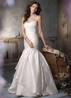 Jim Hjelm Ivory Silk Shantung asymmetrical draped A-line bridal gown, strapless neckline, three tiered irregular hem, chapel train. Crystal embroidered chiffon neck piece with satin ribb