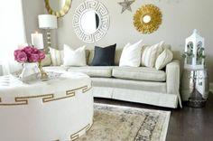 Formal-Sitting-Room-with-Gold-Sunburst-Gallery-Wall-White-Greek-Key-Ottoman